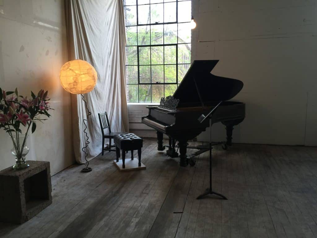 The magnificent and storied piano at Atlas Studios, Newburgh, N.Y. used during Queen of the Hudson concert series