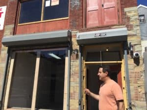 Jeffrey Link looks at the new picture window at 4 Clark Street. The window had been boarded up for over 40 years.